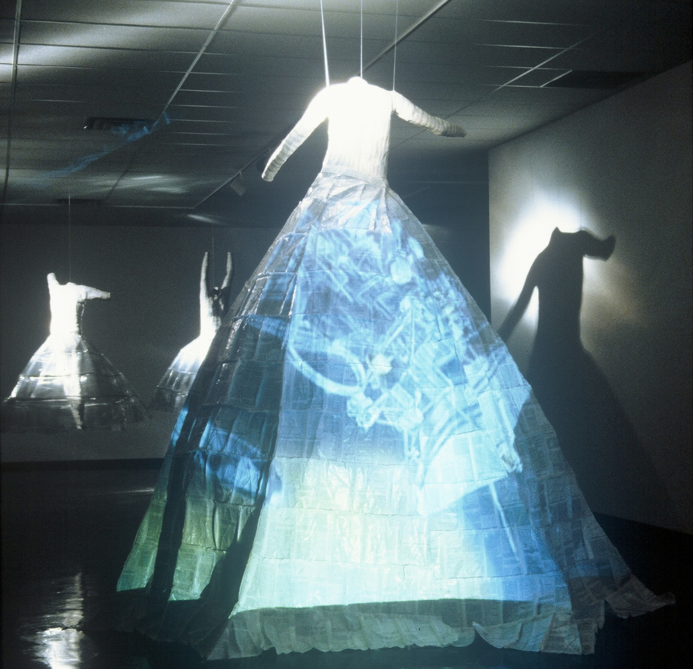 """    A Marriage of Art and Science""   DVD Installation: 2 video projectors, 3 body casts, sewn science papers; 2001 - 03"