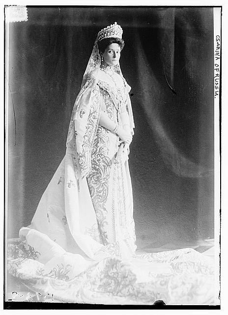 Empress Alexandra in a massive Imperial tiara of diamonds and pearls by Bolin, and a heavily embroidered court gown. the collar of  true Order of St. Andrew, and the scarlet ribbon of the Order of St. Catherine. This same dress is shown below.