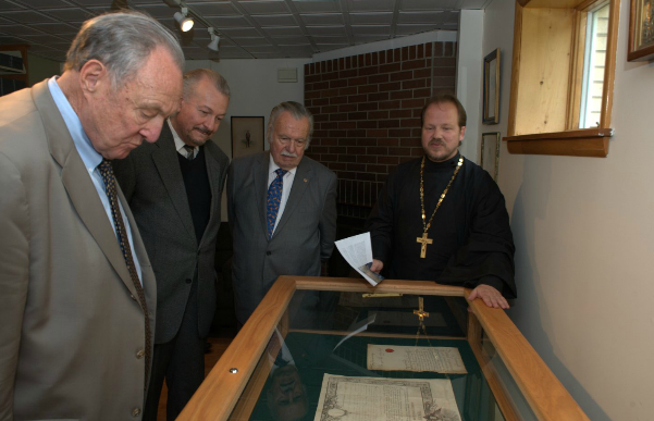 Mr. Warren Hutchins, Mr. Alexandre Neratoff, and Dr. Cyril Geacintov of the Russian Nobility Association are shown an exhibition by Father Vladimir (von Tsurikov) at the RNA Reading Room at Holy Trinity Monastery