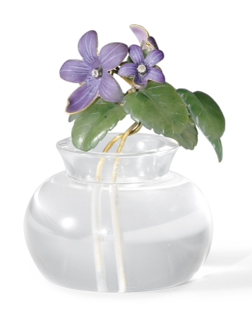 A Fabergé enamel and hardstone flower arrangement of a violet.