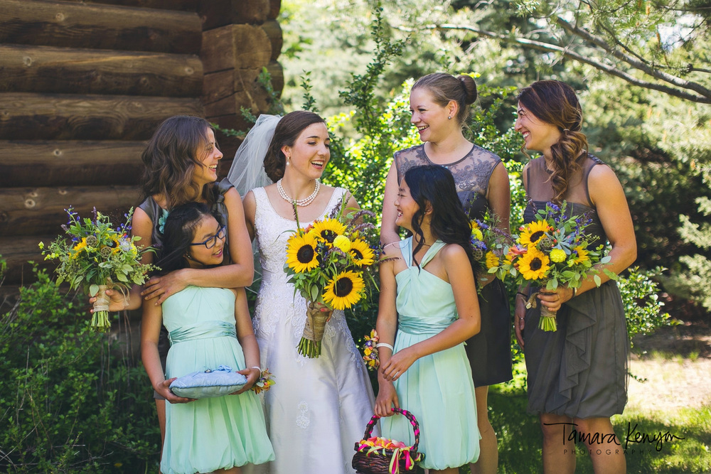 bride and bridesmaids laughing boise wedding photographer