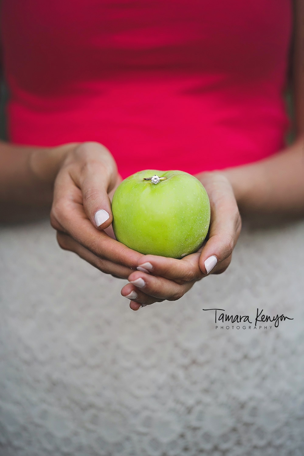 engagement ring on an apple
