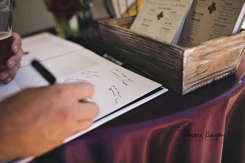 wedding guests signing guestbook