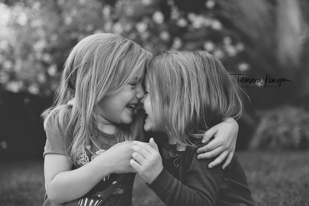 sisters laughing together