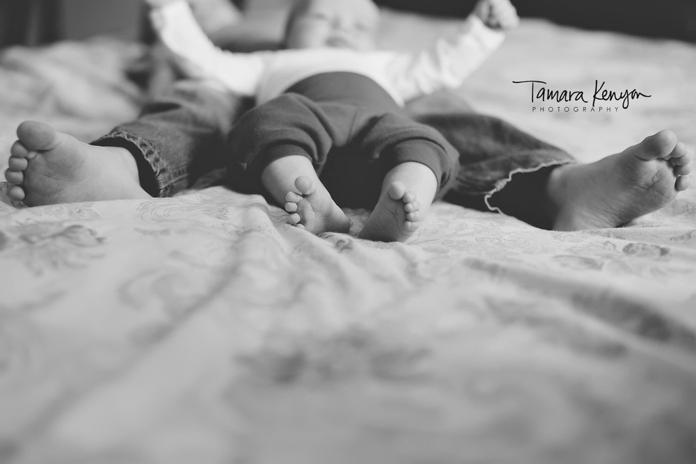 baby and sibling feet