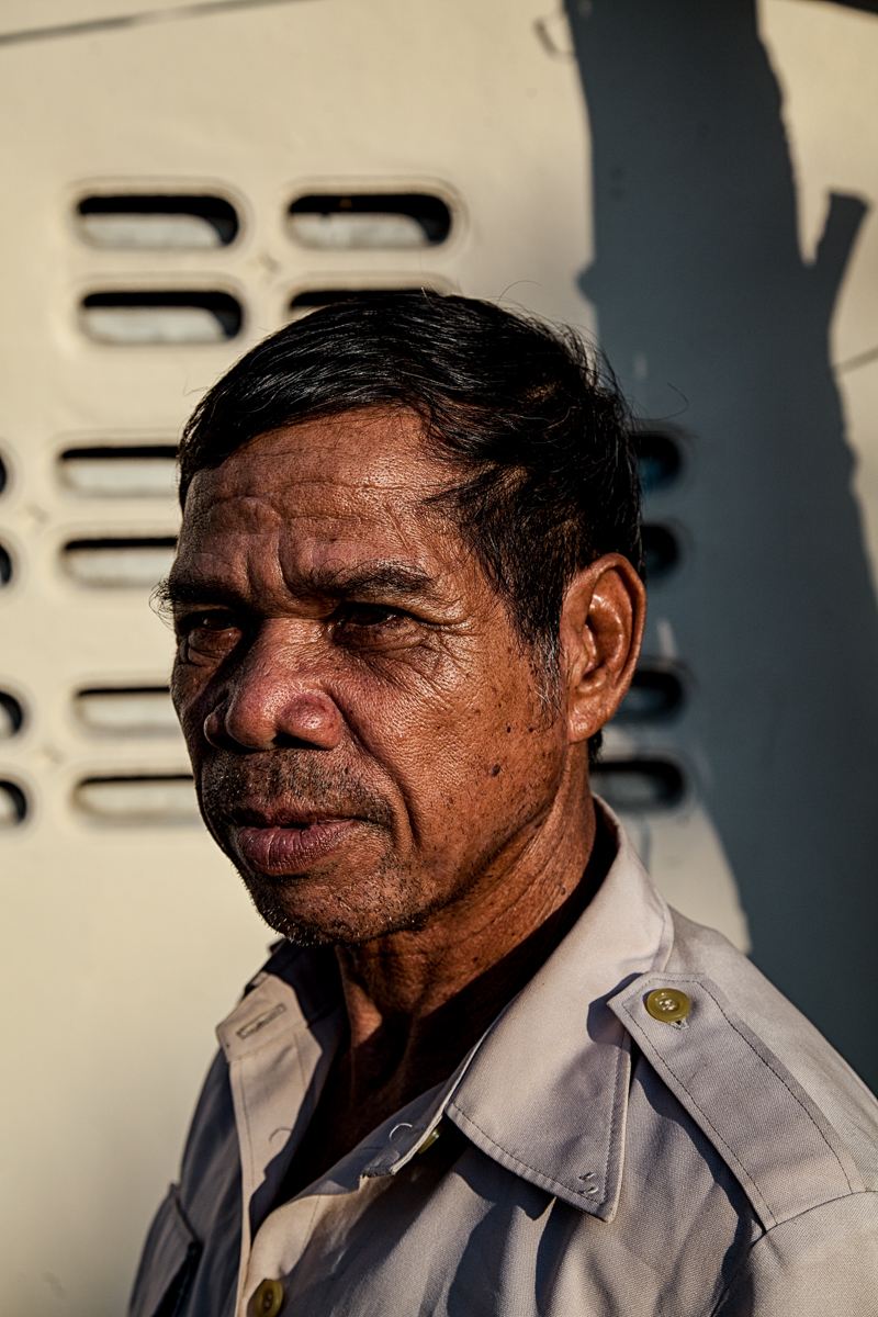 "Nay Bro, 62, Bangkok, Thailand, Feb. 4, 2017. One of the organizers of the 2001 protest that shook the Central Highlands, he now lives in Bangkok as a refugee with no papers. Jailed and beaten for 7 years for organizing a demonstration that demanded human rights, freedom of religion and an end to land grabbing policies.  ""I will never, ever go back,"" he says. ""My son is still in jail. It's been 12 years now; I don't know what happened to him."""