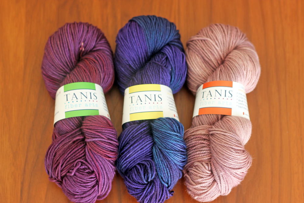 "Green Label Aran Weight in 'Moody Purple', Yellow Label DK Weight in 'Luxe', Amber Label Cashmere/Silk DK Weight in ""Coppertone 2' (a rosier version of our Coppertone colourway)"