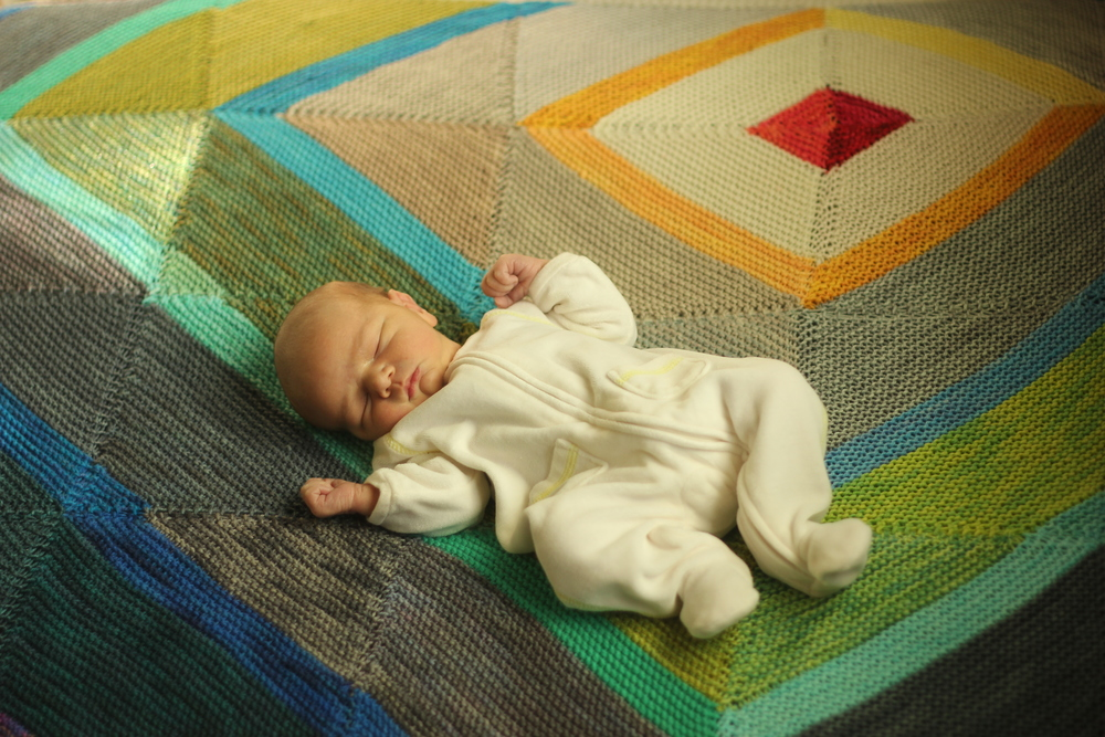 Micah at 4 days old on his  Fly Away Blanket .