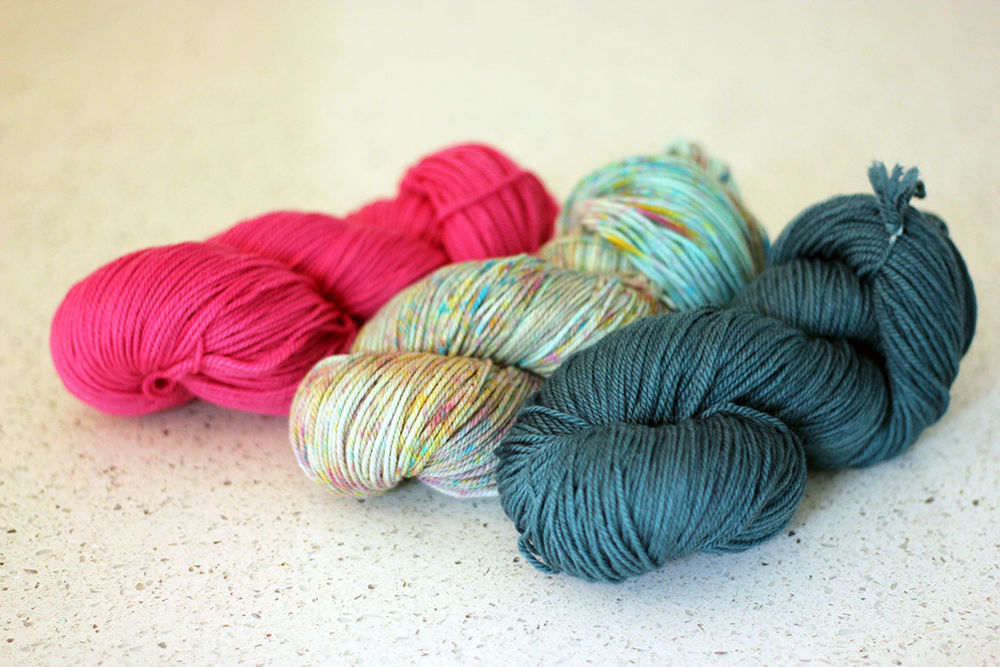 TFA PureWash DK in colour ways: Orchid, Hummingbird and Ravine.