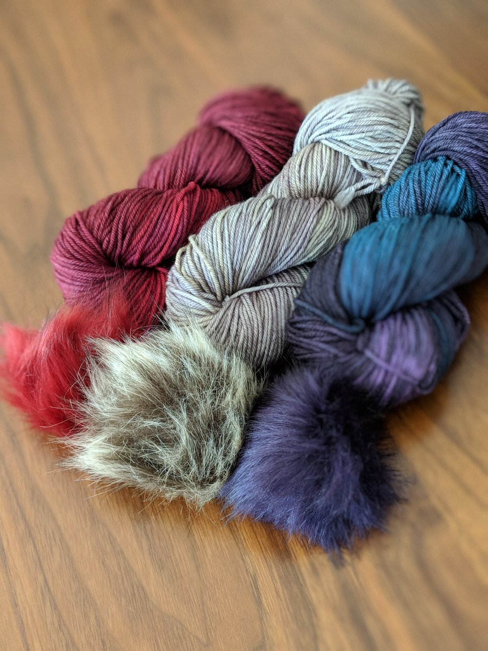 This is an order I mailed earlier this week. Someone is ready for hat weather and I am inspired! May have to cast on for a hat myself this weekend. Pictured yarn/pompom combos are Garnet/burgundy, Stone/brown, Fig/deep purple.