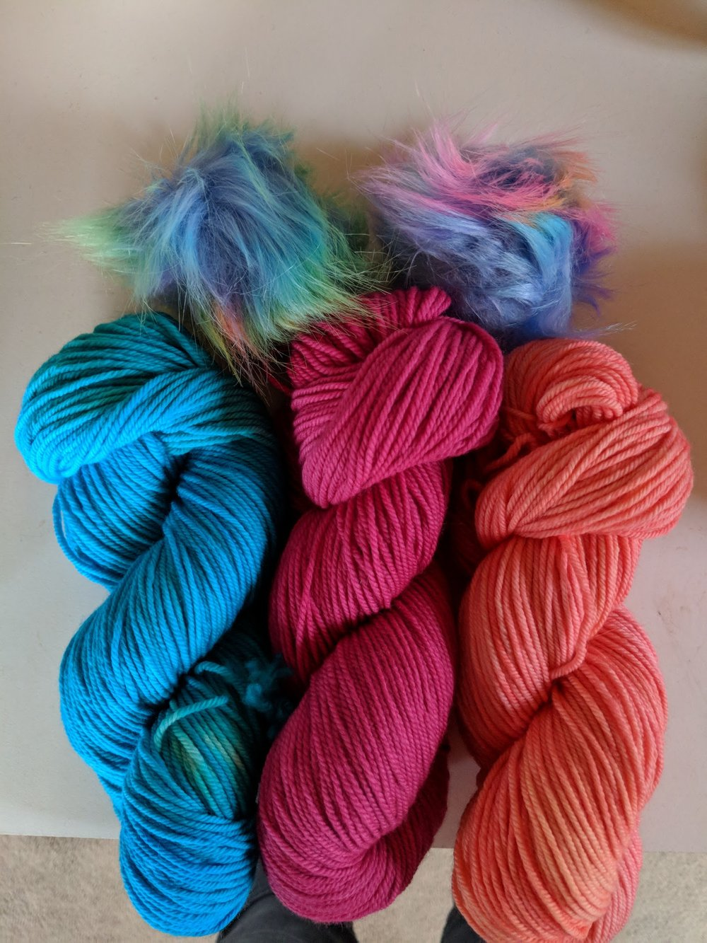 Putting together yarn/pompom options for a customer. Hat plans are in the works!