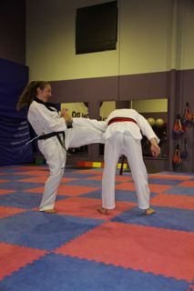 Senior Black Belts demonstrating their self-defence