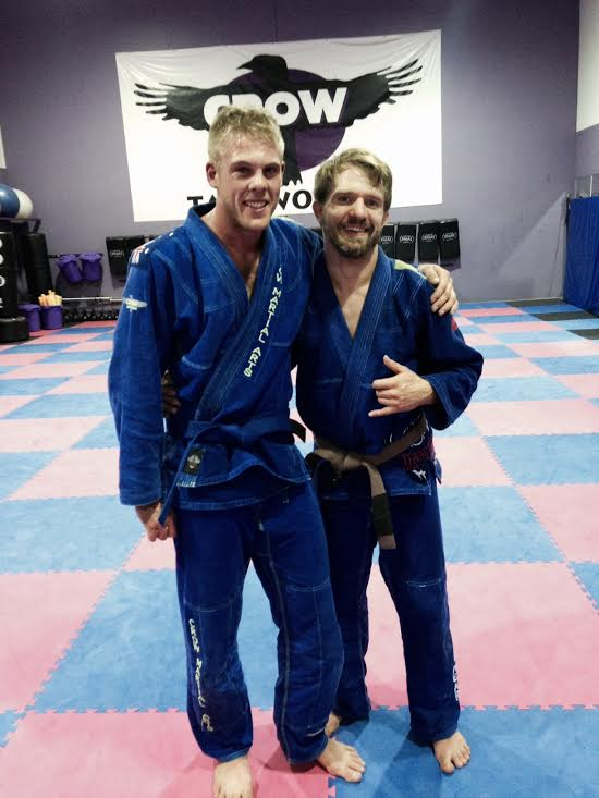 Our new blue belt Zac with coach Tim