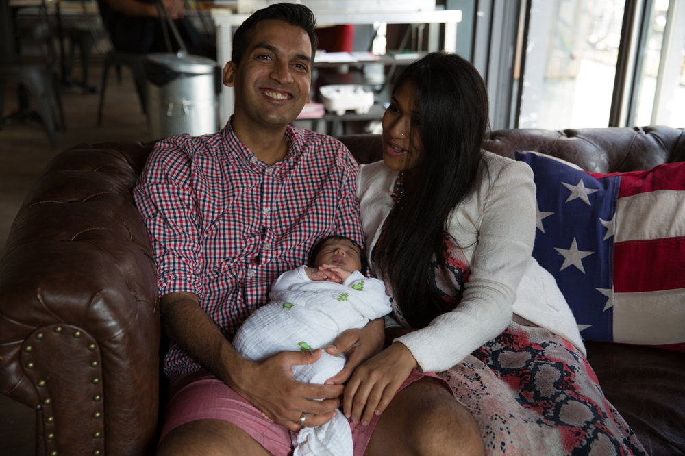smiling-man-and-women-holding-new-baby.jpg