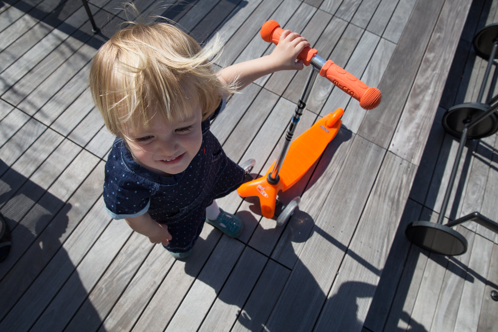 blond-little-girl-with-orange-scooter.jpg