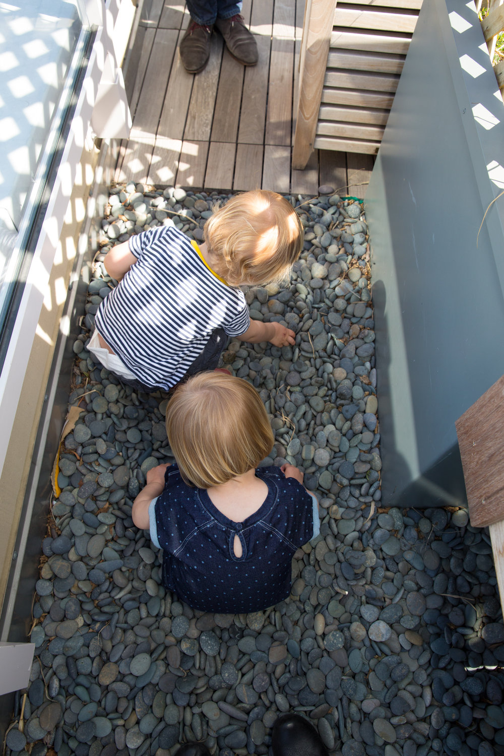twins-playing-in-pebbles.jpg