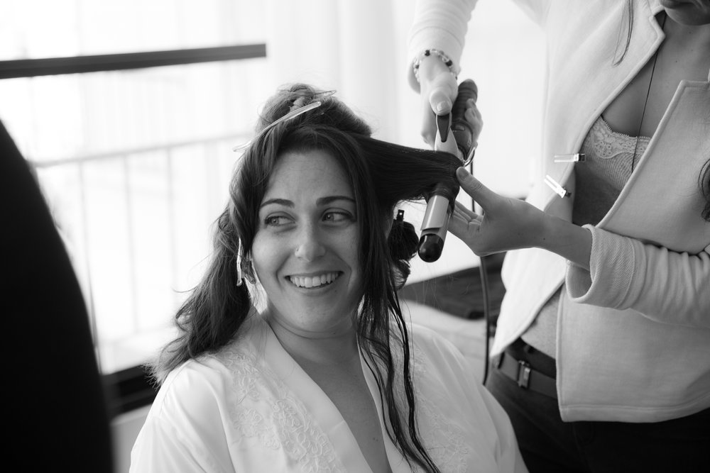 bride-getting-ready-with-curling-iron.jpg