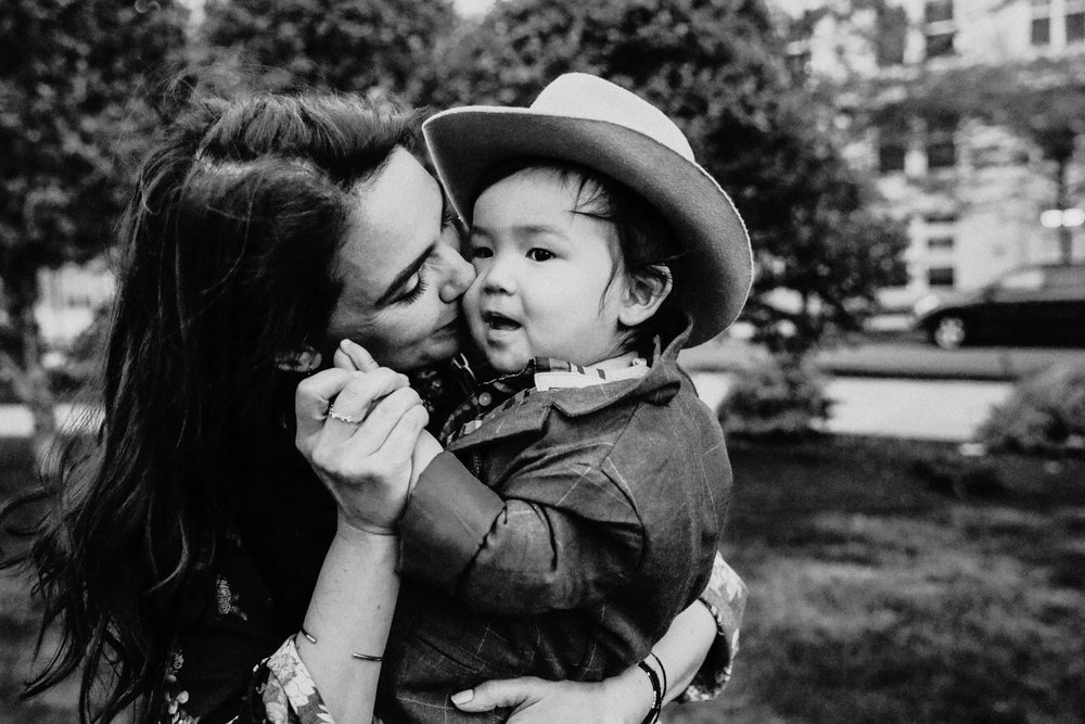 mom-kissing-babyboy-with-hat.jpg