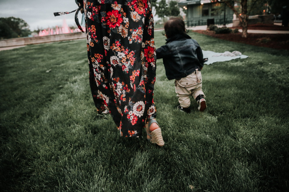 Mother-in-flower-dress-walking-with-son-overalls.jpg