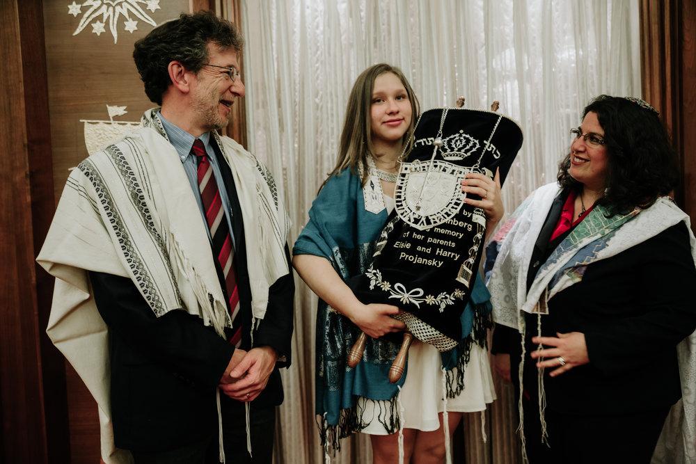 teen-girl-holding-Torah.jpg