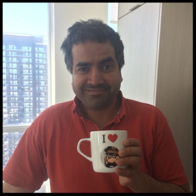 Hari and his coffee (love the Tintin mug - I [heart] Captain Haddock, too!)