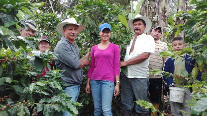 Ecuadorean coffee farmers with their crop