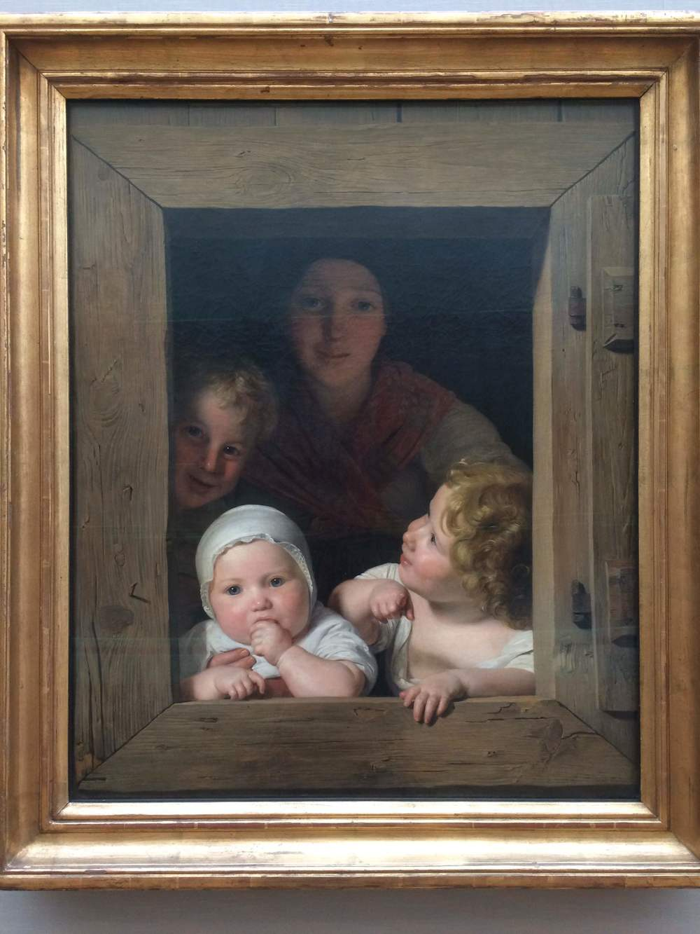 FerdinandGeorg Waldmüller Young Peasant Woman with Three Children at the Window