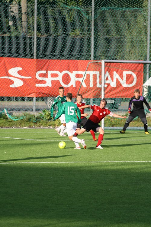 Madis with captain armband tackling a Levadia attack in another legendary cup fixture: FC PokkeriProd vs. Levadia 0-18 (FCPP Facebook page)