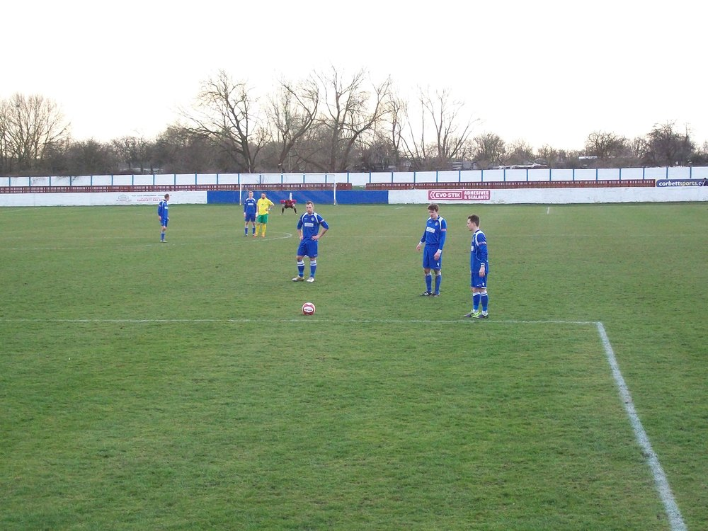 The referee only awards a free-kick, much to the ire of the Frickley faithful