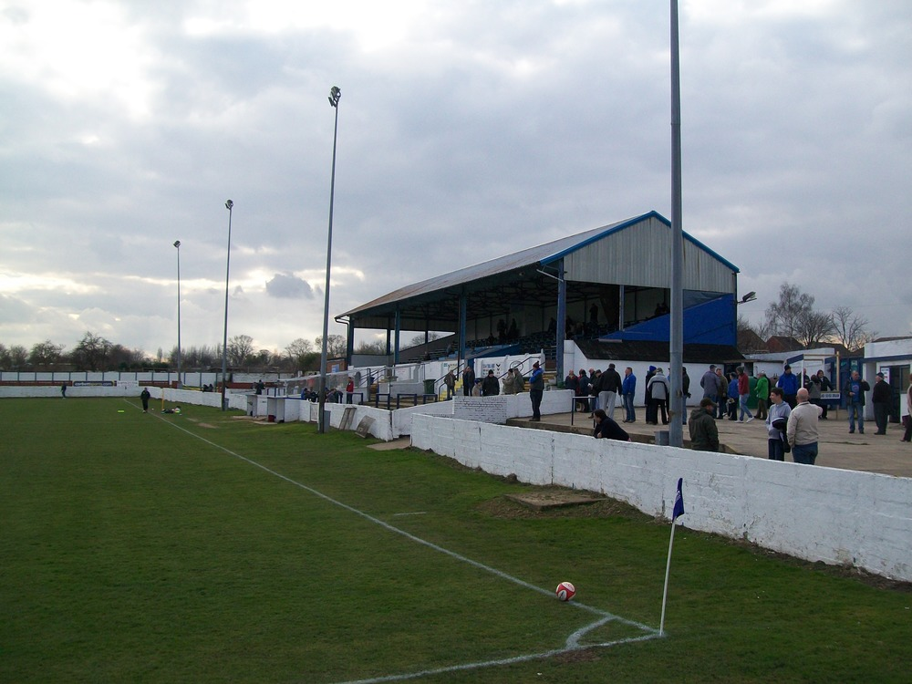 A view of the main stand and brick retaining wall