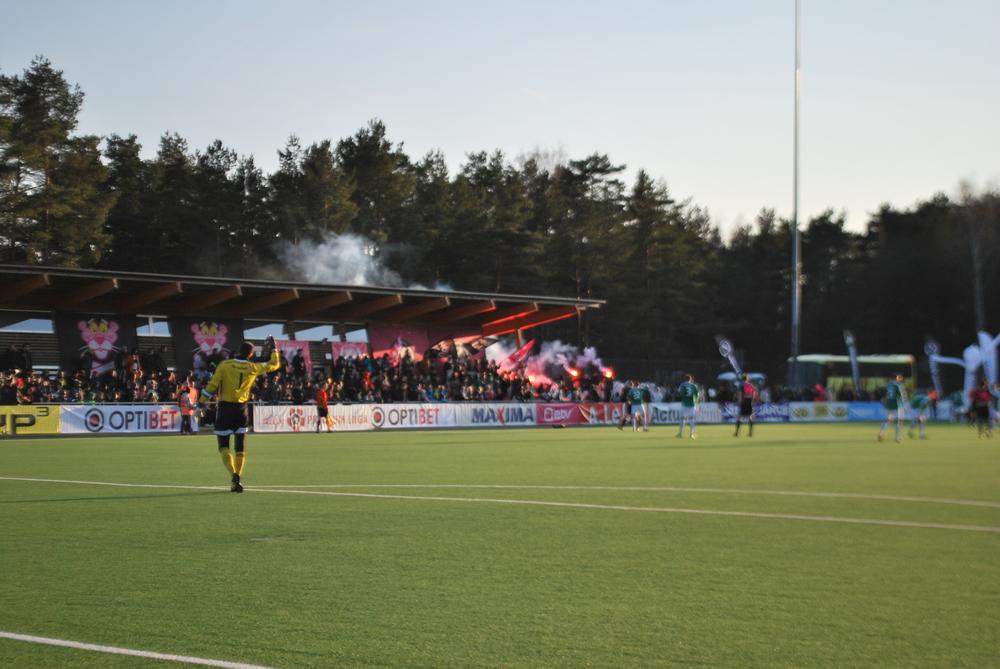 Kalju fans light up pyro while Smiśko observes the action