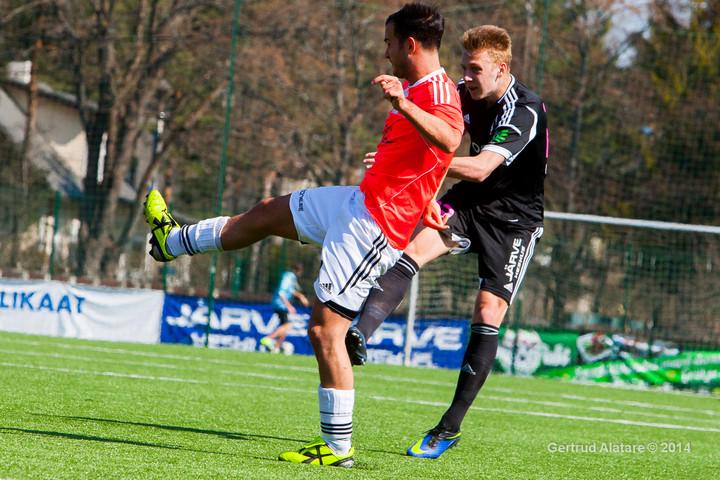 Andrea Castelnovo (left) in action against Nõmme Kalju double team with Puuma's hersey (Getrud Alatare)
