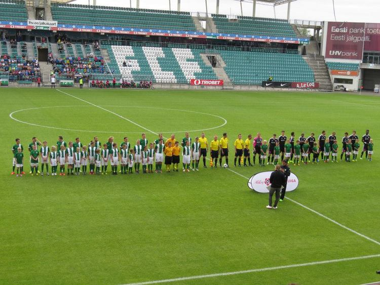 The teams line-up in front of a lively crowd
