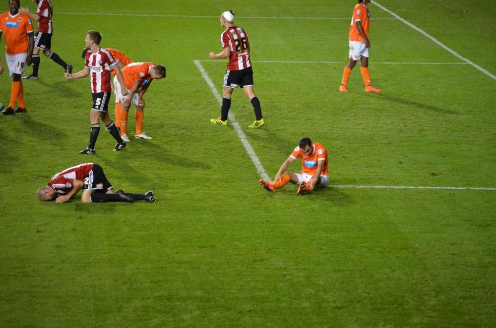 End of game, Blackpool players on their knees