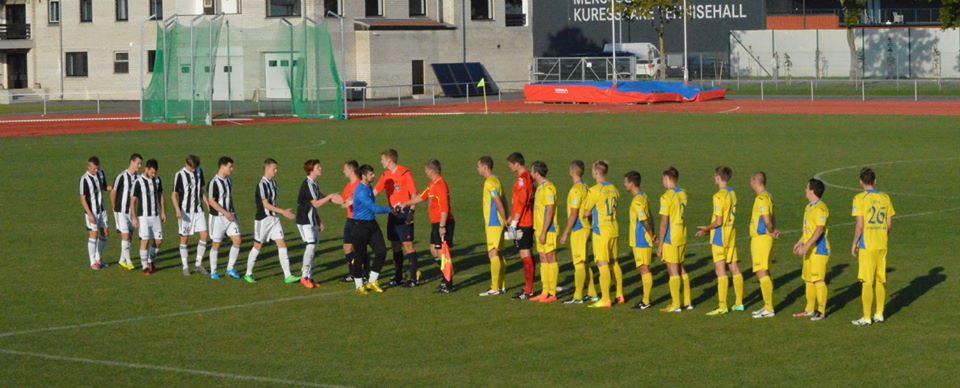 FC Puuma (in black and white) start with 8 men only (FC Kuressaare Facebook page)