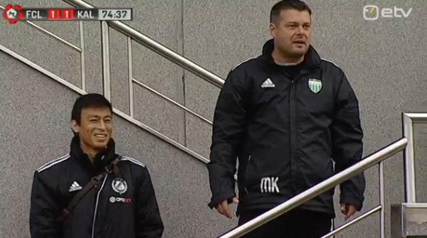 Wakui has a smile at Kristal temper from the lodge stairs. It's still 1-1...