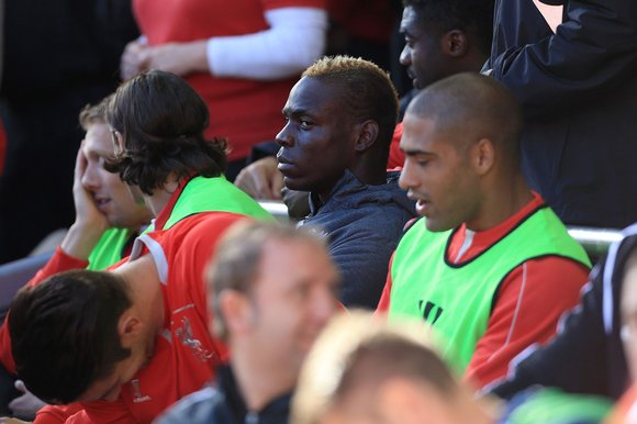 Balotelli looks on from the Liverpool bench image: thesundaytimes.co.uk