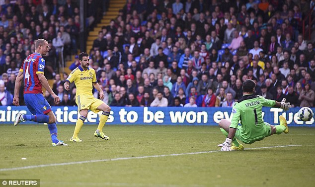 "Fabregas slots home a goal which boss Mourinho described as a ""scandal"" image: dailymail.co.uk"