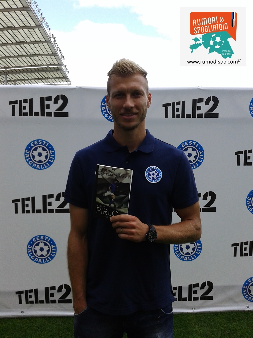 Ragnar Klavan with a copy of Andrea Pirlo's biography gifted by Rumori in September