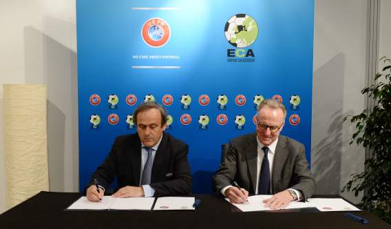 Once rivals on the pitch, Platini and Rummennigge sit behind the same table for UEFA and ECA to sign the joint document (ECA)