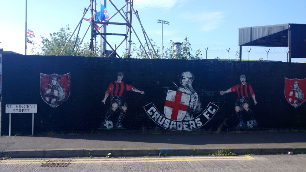 In a city full of wall murals, Crusaders show their colours.