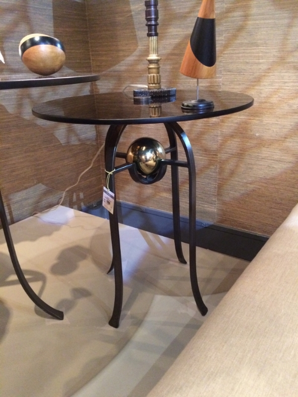 As I was taking a picture, the designer of this table approached me. It was created by  Barry Dixon . The gold ball comes out. He wants people to play with his pieces. He said you could put a birds nest in it, instead of the gold ball. So playful! Interestingly, this collection was inspired by medieval combat. So many of the pieces seem armored and sharp. Mixed with some rounded bulbous shapes. The sconce was inspired by a fencing mask.