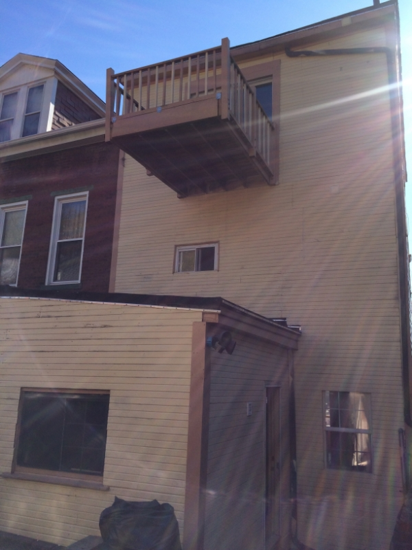 The balcony is now a Juliette balcony and all siding and windows are new.