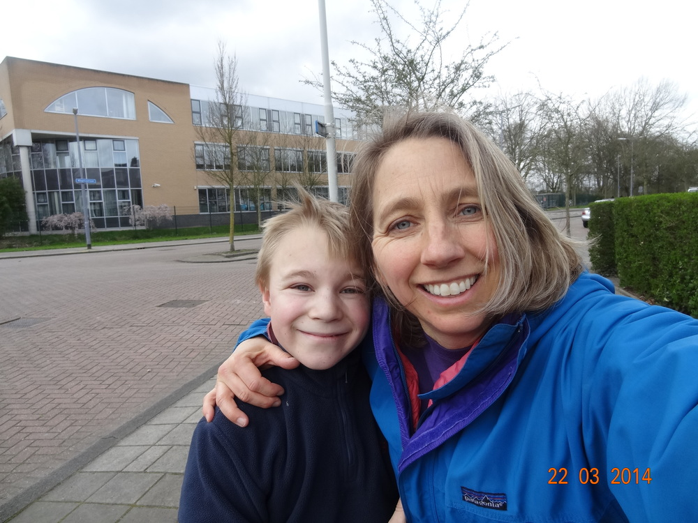My son and I in front of the school.  The wonderful bike paths here in the Netherlands allow us to roller blade  anywhere . However, he chose the school.  Partly, I think, because he  really  likes it there.