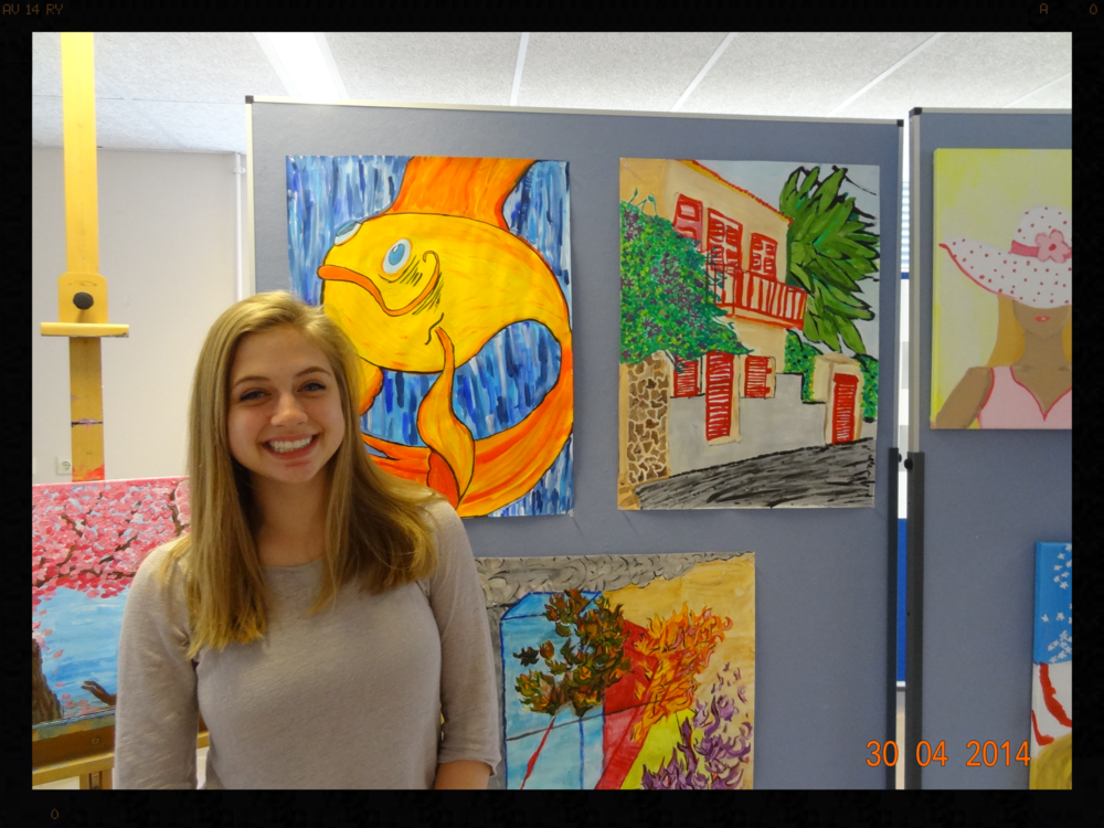 My daughter in front of some of her art.