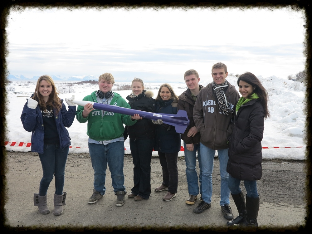 Students with my colleague and me  in the arctic circle for our CanSat trip.