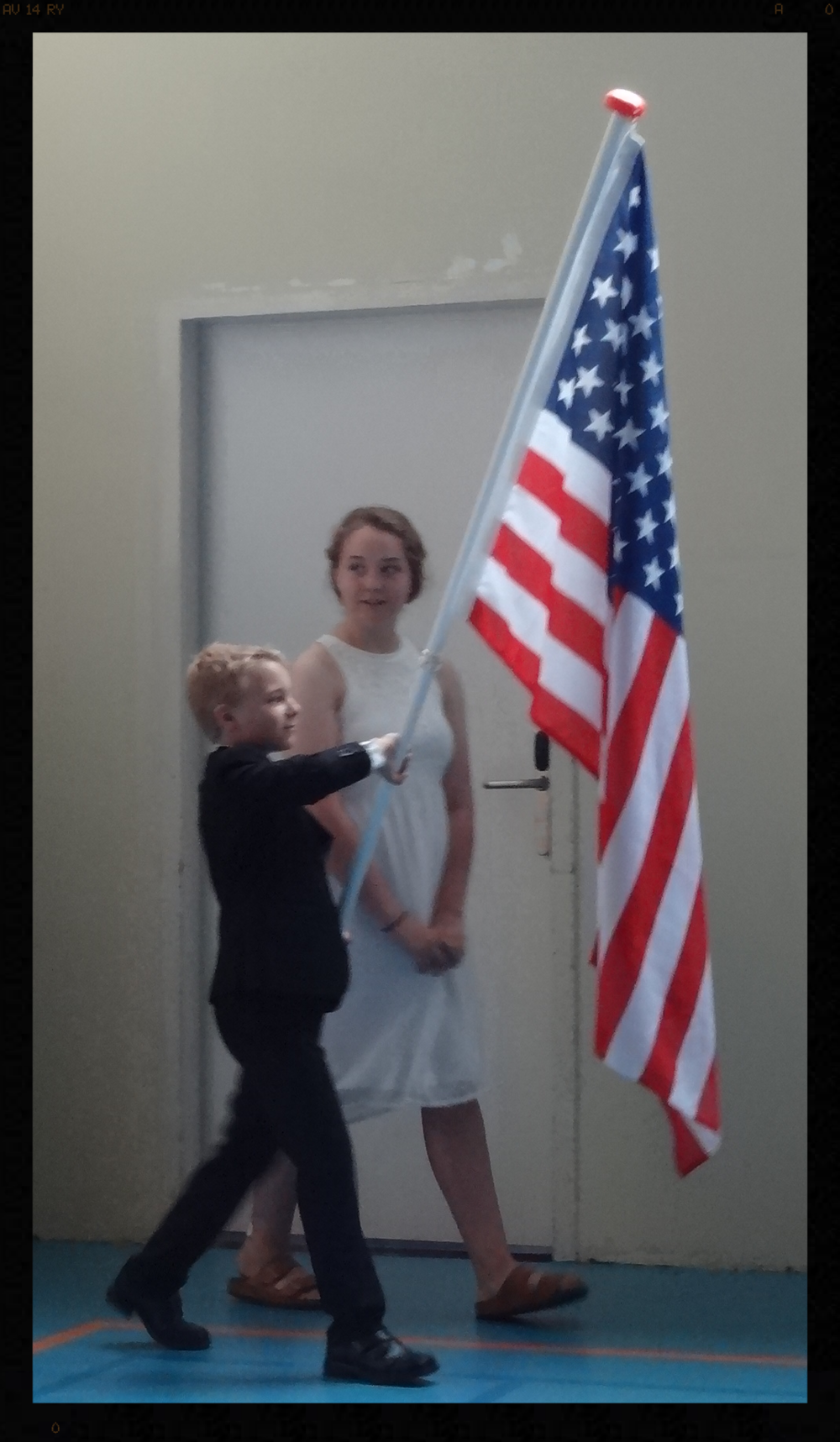 Our youngest carrying the flag for his graduating teenage siblings.