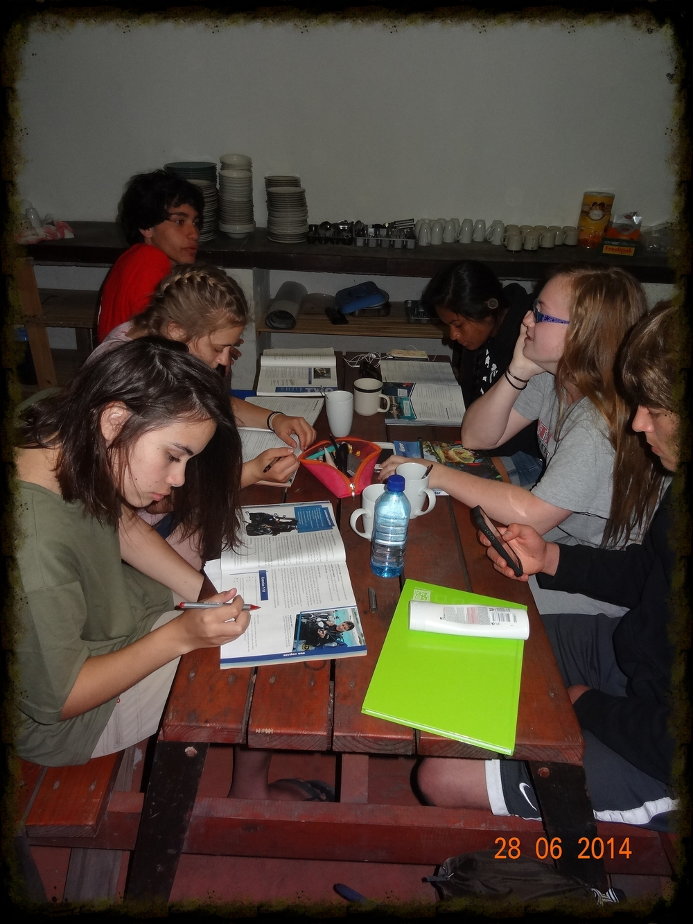 Students studying from their dive manuals in the mess hall, even though there will be no grade assigned to the HW.