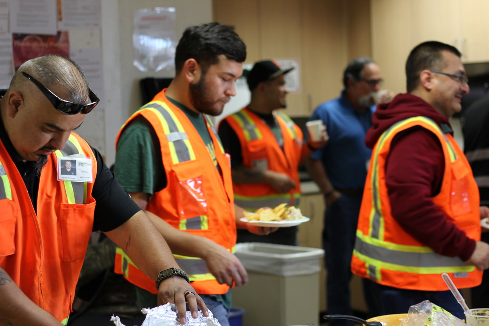 Employees enjoying a Thanksgiving potluck
