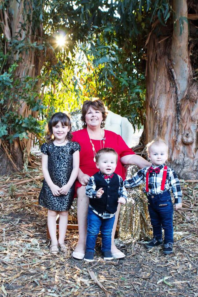 Julie with her grandkids - Emery, Easton and Archer.
